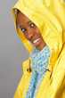 Young Woman Wearing Yellow Raincoat In Studio