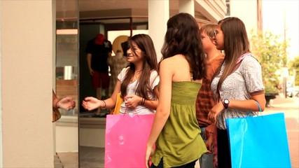 Teenagers Window Shopping
