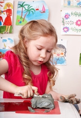 Child  playing clay in play room.