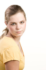 Headshot portrait of teenage girl in yellow blouse