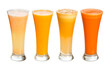 Four glasses of fresh juices. Grapefruit, orange, apple, carrot.