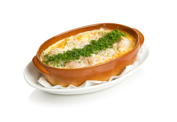 Baked zander with egg, red pepper and leek
