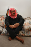 Moroccan  Militia Man with AK 47  at Home