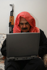 Moroccan  Militia Man with AK 47 on Laptop