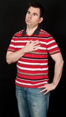 male having chest pain on black backdrop