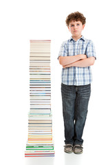 Student standing close to pile of books on white background