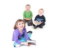 Happy kids reading books
