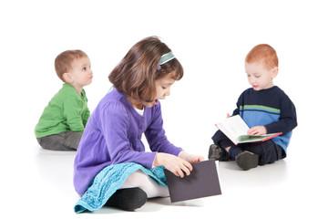 Sitting kids reading books