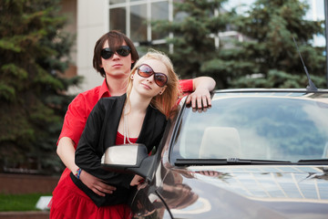 Young couple with a new car.