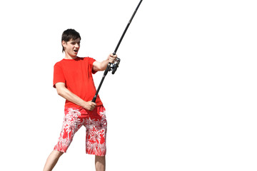 a young man in shorts and a T-shirt with a fishing rod