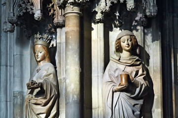 Two Saints in the lighting through the gothic window