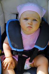 Baby girl in child safety car seat