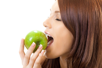 Young woman eating apple, isolated on white
