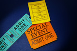 assorted ticket stubs on blue poster