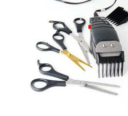 barber electric clippers with scissors, on white