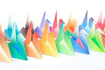 2 rows of colourful origami birds. Shallow depth of field.