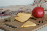 Still-life with cheese and tomato.