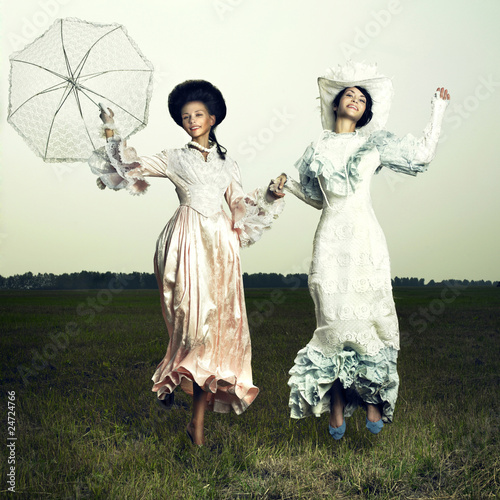 Two woman in vintage dress - 24724766