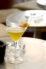 Illusion Daiquiri with orange flower in a martini-glass.