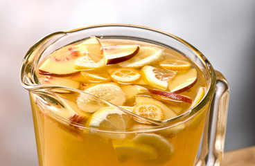 blanca sangria with pieces of apple, banana, oranges and lemon