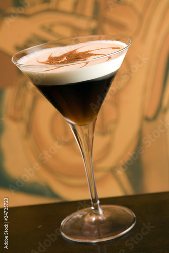white russian cocktail with a cream in a martini glass