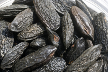 black tonka beans laying in the sun