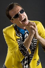 rockabilly singer from 1950s in yellow jacket