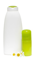 Spa cosmetics bottle with chamomile flower