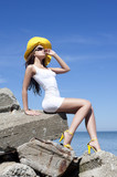 Young woman with yellow hat and sunglasses