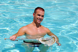 Muscular man playing in pool