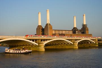 power station with raiway bridge and tourist boat