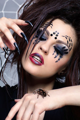 spider girl and spider Brachypelma smithi