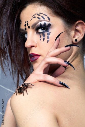 spider-girl and spider Brachypelma smithi