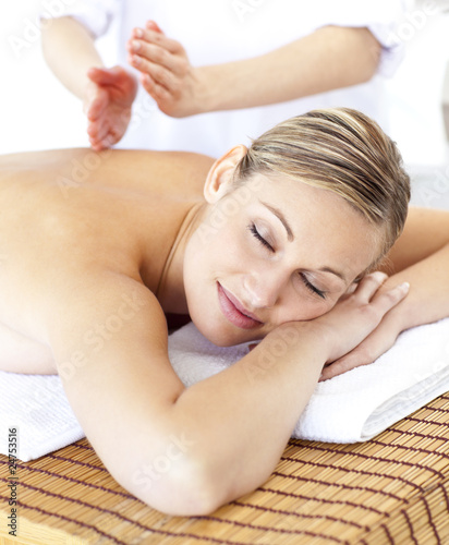 Attractive caucasian woman receiving a tapping massage