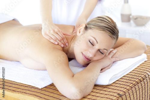 Positive woman having a back massage