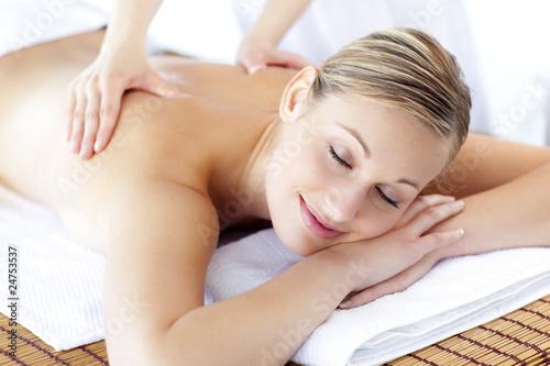 Relaxed caucasian woman receiving a health treatment