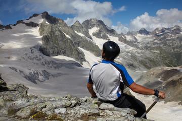 Man looking to a mountain peak