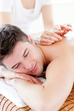 Charming young man in an acupuncture therapy in a Spa center