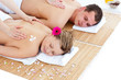 Beautiful young couple receiving a back massage