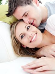 Portrait of a loving boyfriend hugging his girlfriend on the sof