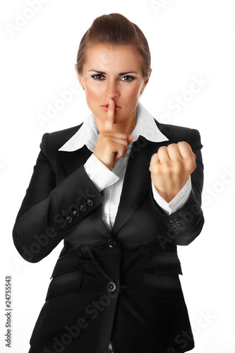 business woman with finger at mouth and threaten with fist