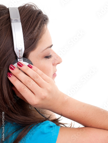 woman in headphones listening music from mp3