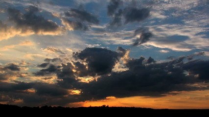time lapse of clouds during sunset