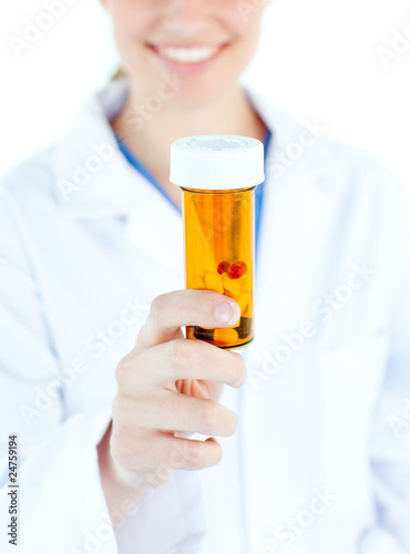 Close-up of blond caucasian doctor holding pills in the camera