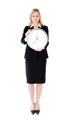 Frustrated businesswoman holding a clock against white backgroun