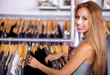 Attractive brunette woman shopping her outfits