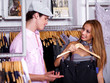Couple shopping in retail cloth store