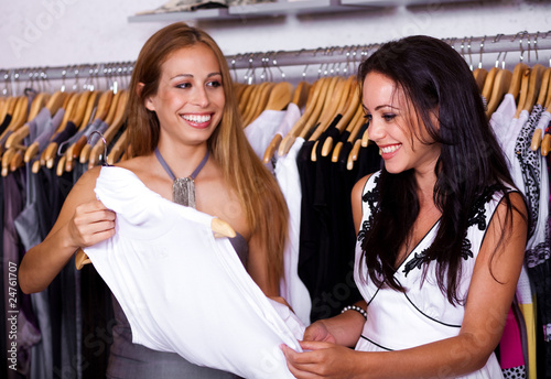 Female sales assistant helping buyer