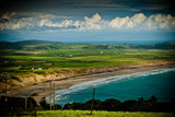 colourful view of welsh coastline beach and fields poster