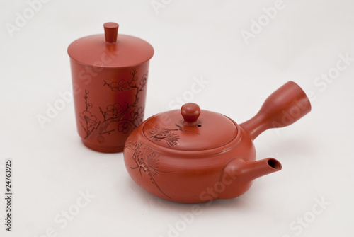 red ceramic chinese tea cups on a white background.